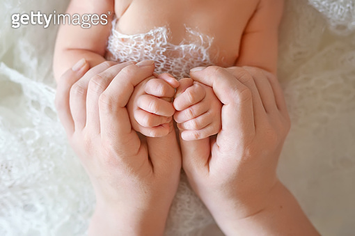 Newborn children's hand in mother hand. Mom and her Child. Happy Family concept. Beautiful conceptual image of Maternity