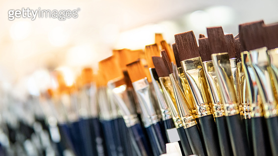 Group of Artistic paintbrushes. New paint brushes on shelf display in stationery shop. Art painting concept