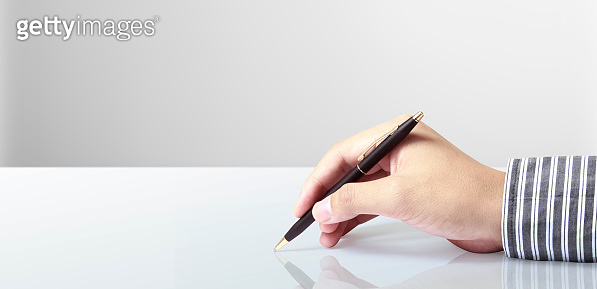 Pen in hand on a white background