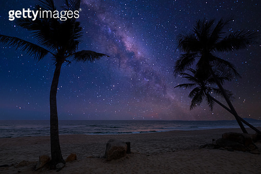 romantic beach and milky way with star.