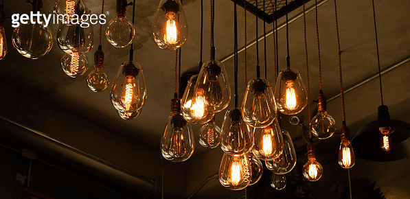 Beautiful vintage luxury light bulb hanging decor glowing in dark.