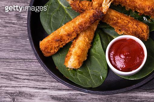 Tempura deep fried shrimp fish with tomato sauce. street food.