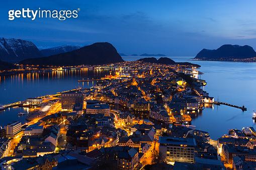 Scenery of Alesund city over Norwegian Sea at dusk