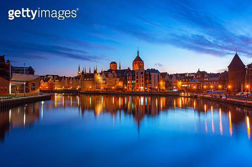 Gdansk with beautiful old town over Motlawa river at dusk
