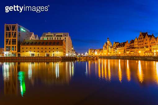 Old town in Gdansk with reflection in Motlawa river at night