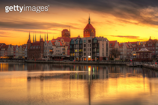 Gdansk with beautiful old town over Motlawa river at sunset
