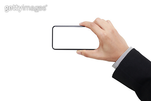 Woman hand holding and showing blank smartphone screen on isolated white background with clipping path display concept.Hand of business man hold smartphone take pictures the landscape horizontal