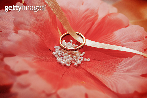 beautiful gold wedding rings on the pillow