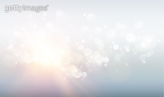 Abstract rays with bokeh over blue sky. Glitter defocused lights. Sparkle bokeh background.