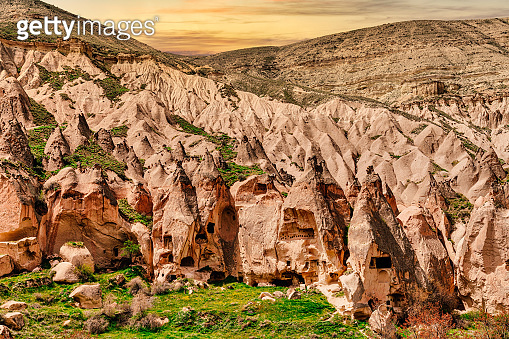 Zelve, Cappadocia, Turkey, Fairy Chimney rock hoodoos and houses caved in the mountain..