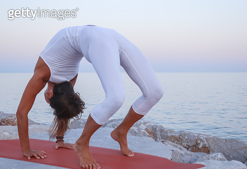 Woman performing a Wheel pose Yoga position