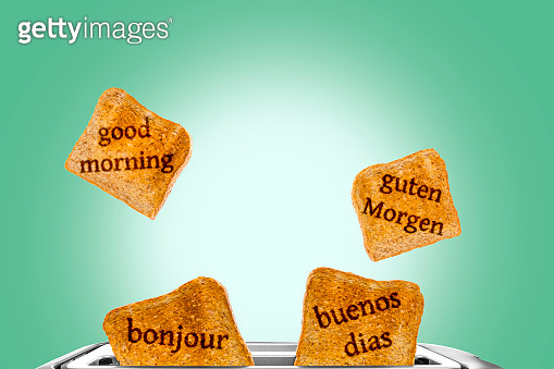 fresh crispy toastbread is jumping out of a toaster - good morning