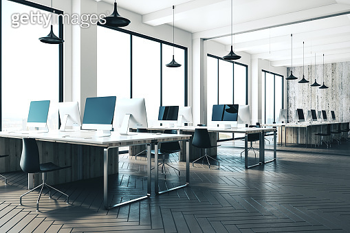 Coworking office interior with computers