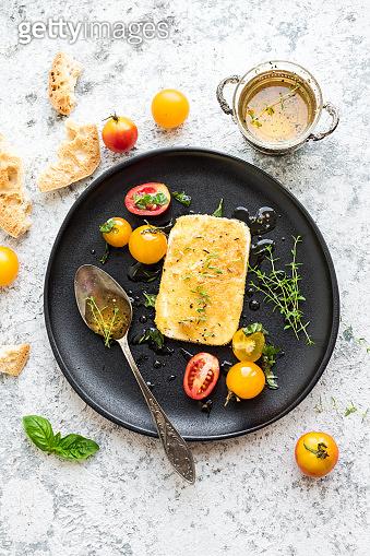 Pan-fried salty feta cheese coated in breadcrumbs