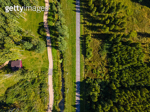 Green park with footpath. Aerial shot. Directly above