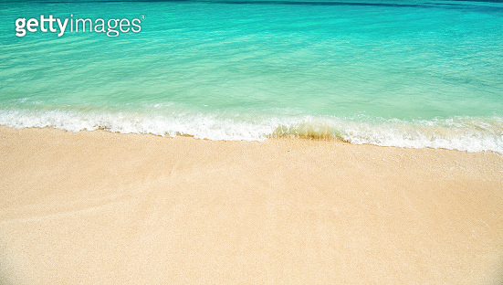 wavy water background on sand