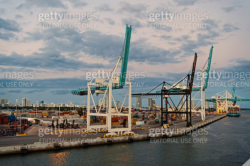 maritime container port with cranes and cargo containers. Port or terminal on cloudy sky. Freight shipping delivery logistics and merchandise concept