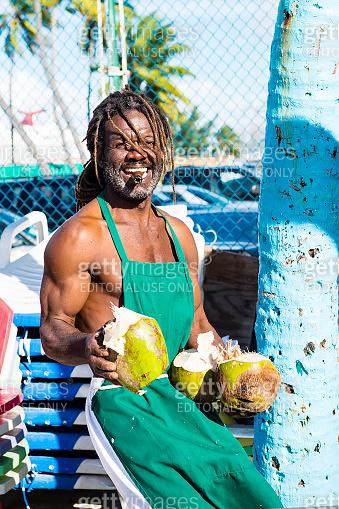 Man breaking coconut