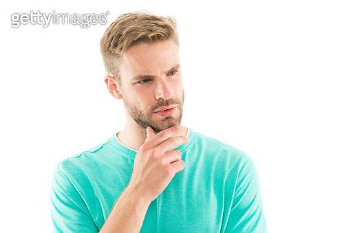 Facial hair has become more fashionable again. Serious man touch beard. Handsome guy with stylish beard shape. Beard grooming. Beard barber. Barbershop. Hair salon, copy space