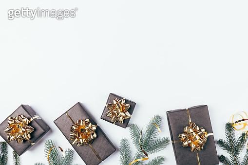 Festive Christmas flat lay border composition of black gift boxes