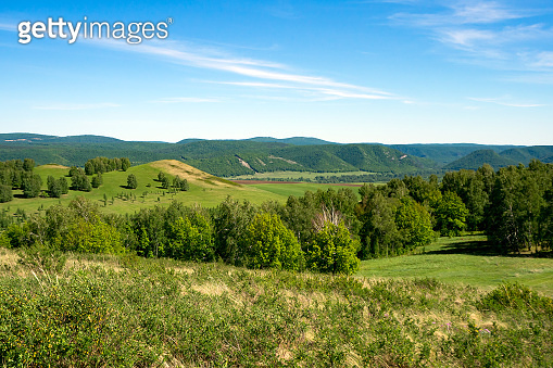 Spring mountain landscape overgrown with green forest. Panorama. Ural mountains.