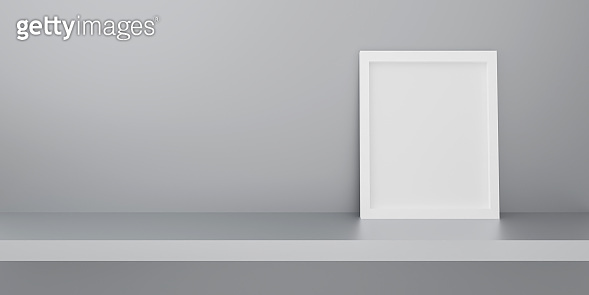 White paper frame photo isolated on gray background in gallery. Empty shop shelf on wall. Realistic picture frame on book shelf. 3d rendering design for mockup, display product object. Interior home.