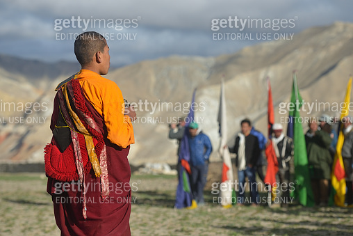 Young monk performs the religious rite of Tibetan Buddhism in front of the people during the Tiji festival in the capital of Lo Mantang kingdom of Mustang, Nepal.