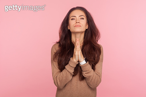 Please, I beg you! Portrait of worried young woman with brunette hair praying for help, expressing big hope