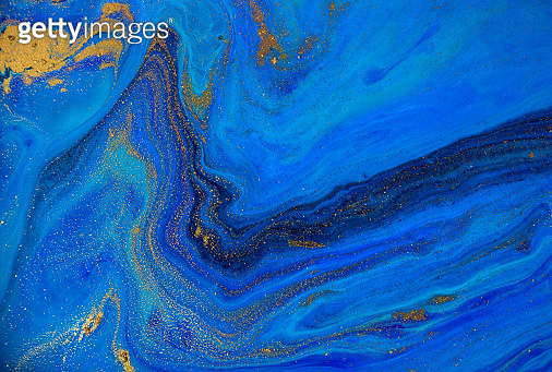 Marbled blue and gold ocean background. Liquid marble pattern.