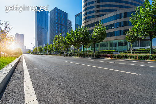 city empty traffic road with cityscape in background
