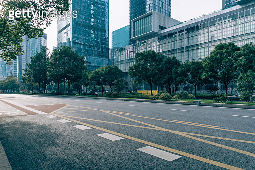 empty urban road with modern building in the city