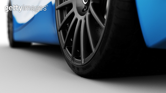 blue sportscar rear wheel isolated on white
