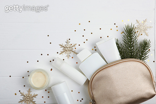 Winter care cosmetics on a colored background top view, place to insert text, minimalism. Skin care, skin hydration