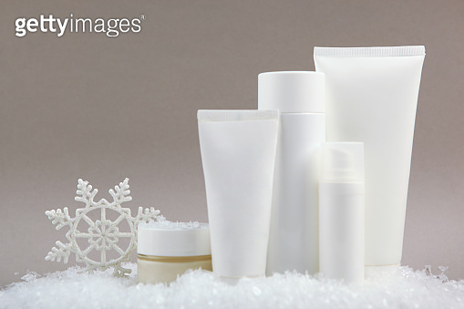 Winter care cosmetics on a colored background, place to insert text, minimalism. Skin care, skin hydration