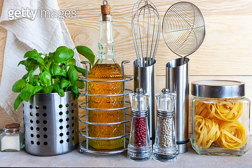 Jars of cereals, kitchen utensils and home plants. Healthy surroundings, comfortable kitchen, sustainable lifestyle concept.