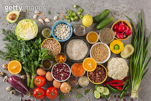 concept balanced diet of fruits, vegetables, seeds, legumes, grains, cereals, herbs and spices. Products containing vitamins, mineral salts, antioxidants, fiber, concrete background.