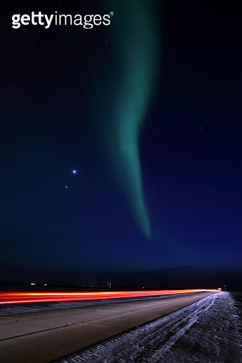 Northern lights on night road on the Yamal Peninsula in Russia