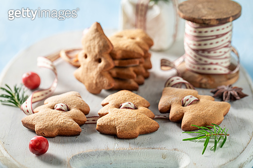 Closeup of chain made of gingerbread cookies as Christmas decoration