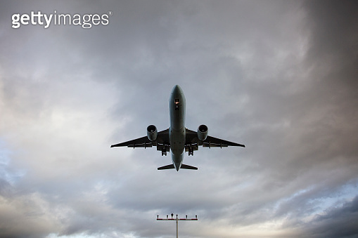Low-angle view of a landing airplane