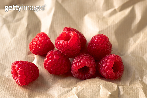 Fresh raspberries in wrapping paper