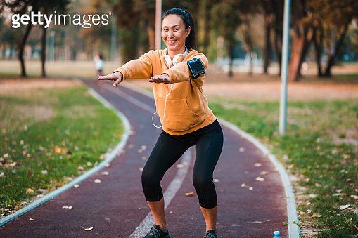 Confident adult exercising outside