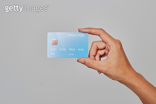 Human hand holding bank credit card. Financial and money payments concept in flat style.