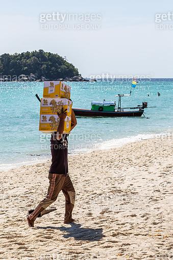 A man carrying a box