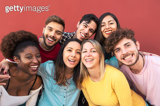 Group multiracial people having fun outdoor - Happy mixed race friends sharing time together - Youth millennial generation and multiethnic teenagers lifestyle concept - Red Background