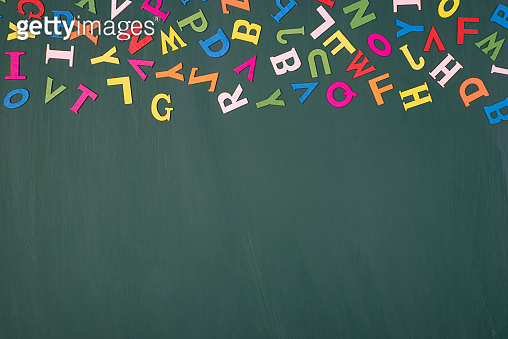 Studying at school concept. Top above overhead view photo of colorful letters above isolated on greenboard with blank empty space