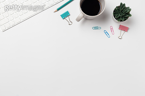 Top view, Workspace desk With coffee and office supplies on white background