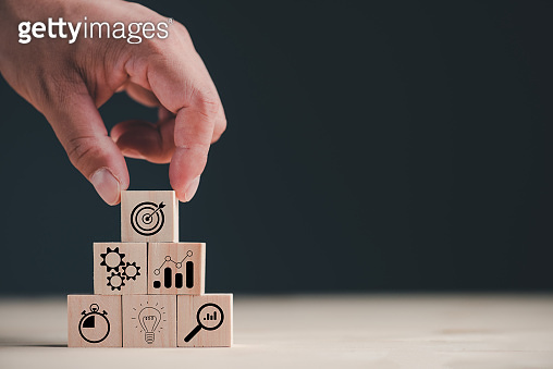 hand stack woods block step on table with icon business strategy and Action plan. business development concept.copy space.