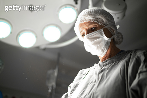 Doctor doing a surgery on operating room in hospital