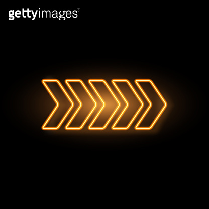 Yellow neon arrow with glowing effect