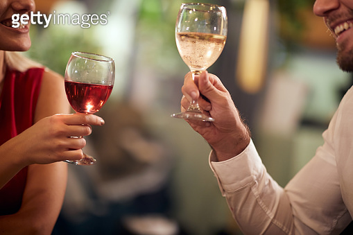 A young couple in love having a drink at Valentine's day celebration in a restaurant. Together, Valentine's day, celebration